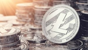 Silver Litecoin coin facing forward on a pile of litecoins