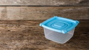 a tubberwear container on a table (TUP)