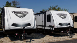Two Winnebago (WGO) vehicles parked outside of an Indianapolis dealership.