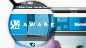 Aware (AWRE) logo displayed on a web browser and enlarged by a magnifying glass