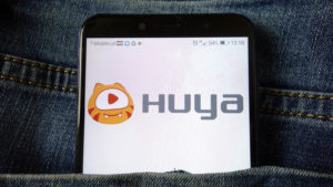 the HUYA logo displayed on a mobile phone