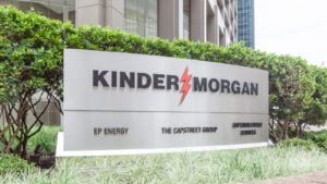 kinder morgan (KMI) sign on grass