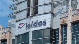 Leidos (LDOS) logo on the side of an office building