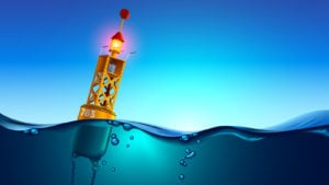 a light buoy in the middle of the ocean