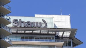 Shaw (SJR) logo on a corporate building