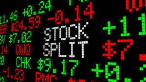 """A digital image of a ticker tape reads """"STOCK SPLIT."""""""