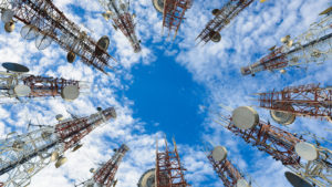 a ground-up view of multiple cell towers in a circle
