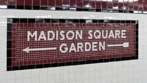 Madison Square Garden (MSGS) sign in New York City subway tile pattern.