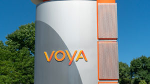 The Voya (VOYA stock) logo on a sign outside a building