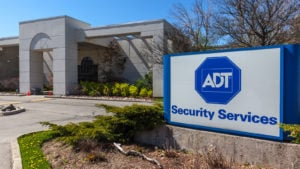 ADT (ADT) home security sign sitting outside of a building