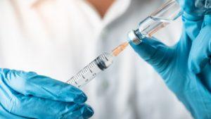 medical professional holding a syringe