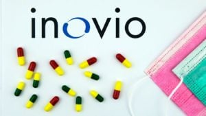 inovio (INO) logo next to pills and face masks