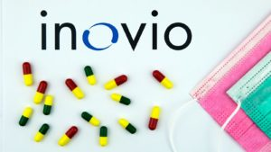 inovio logo next to pills and face masks (stocks to buy)