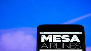 mesa airlines (MESA) logo on a mobile phone with clear sky in the background