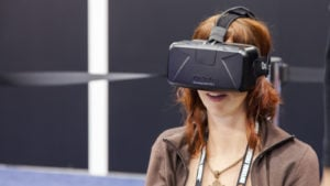 image of a woman wearing a VR headset