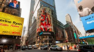 A digital advertisement for The RealReal (REAL) hanging above the Nasdaq Exchange.
