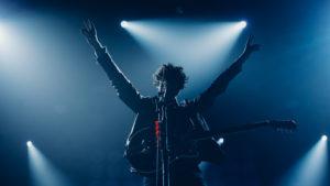 Image of a singer at a rock concert.
