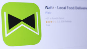 Photo of Waitr (WTRH) logo in a mobile app store browser.