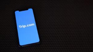 a smartphone displays the Trip.com app