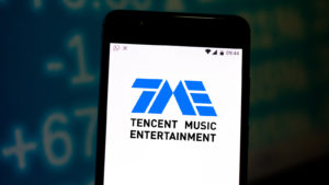 Tencent Music (TME) logo on an iphone screen