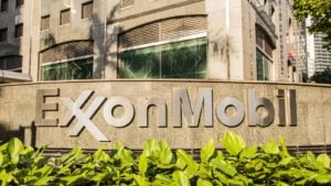 Exxon Mobil (XOM) logo outside of a corporate building