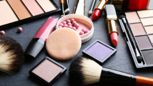 a collection of various cosmetic products on a black table