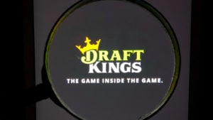 DraftKings (DKNG) logo, magnified, on its app. insider buying