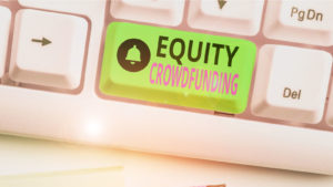 A bright green button on a keyboard that says Equity Crowdfunding.