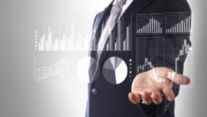 graphs and stock charts are superimposed on a stock image of a businessman