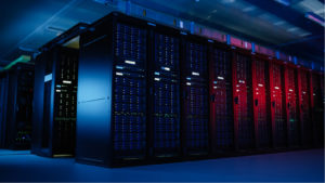 Image of computer servers lined up in a dark room
