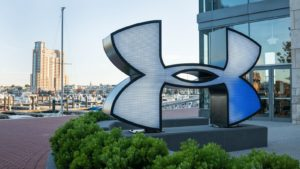 Under Armor (UA) logo in front of Under Armour store in Baltimore Harbor East