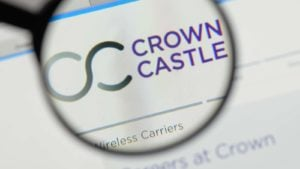 Image of Crown Castle (CCI) logo on a web browser highlighted through the lens of a magnifying glass
