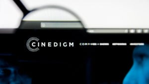 Image of Cinedigm (CIDM) logo in a black web browser, amplified by a magnifying glass.