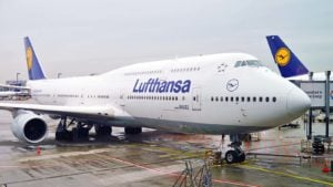 a Lufthansa plane docked at an airport