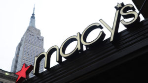 A Macy's (M) sign above a Macy's store in New York City.