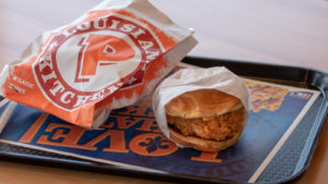 a tray of food from popeyes