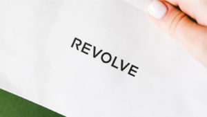 The Revolve (RVLV) group logo is seen on a display.