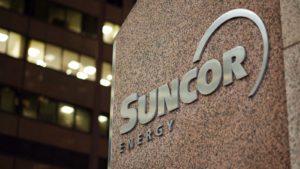 A sign for a Suncor Energy (SU) building.