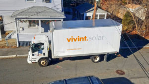 A Vivint Solar (VSLR) installation truck parked out front of a residence.