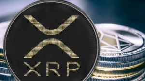 Coin cryptocurrency ripple on the background of a stack of coins