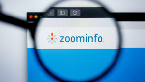Illustrative Editorial of ZOOMINFO.COM website homepage. ZOOMINFO logo visible on display screen.
