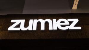 Zumiez (ZUMZ) sign with bright white letters