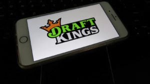 DraftKings logo on a phone
