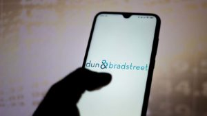 The Dun & Bradstreet (DNB) logo is displayed on a smartphone screen.