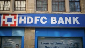 A closeup of the trademark brand logo of HDFC Bank hanging outside their office building in India