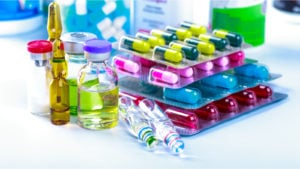 colorful pills and vials sitting on a table