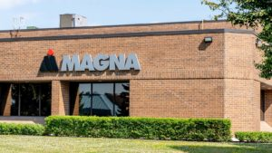 A Magna International (MGA) sign is on the front of a Magna building in Ontario, Canada.