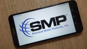 The Standard Motor Products (SMP) logo is displayed on a smartphone.
