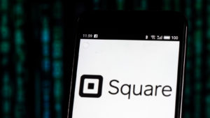 Image of Square (SQ) logo on a mobile phone