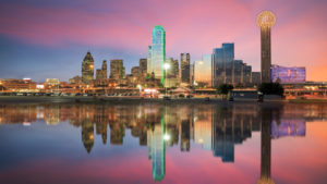 Photo of Dallas, Texas cityscape with blue sky at sunset.